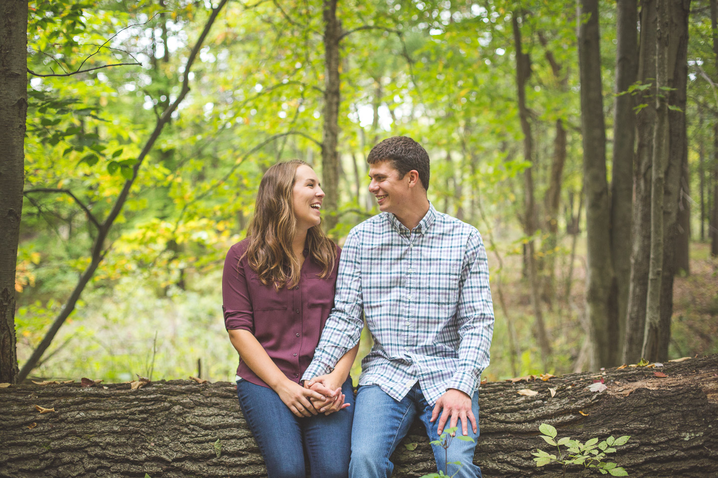 Engagement-Milford-Kensington-Metropark-Forest-Couple-Laughing-On-A-Log