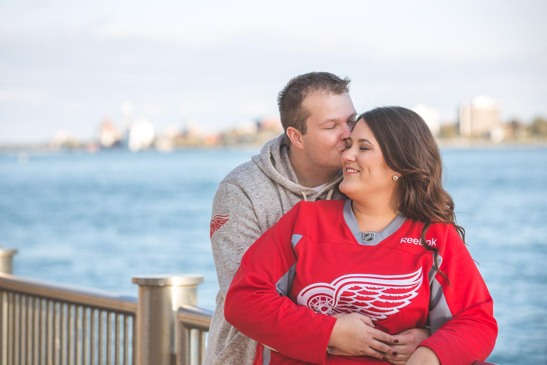 Engagement-Detroit-Kiss-River-Walk-Couple