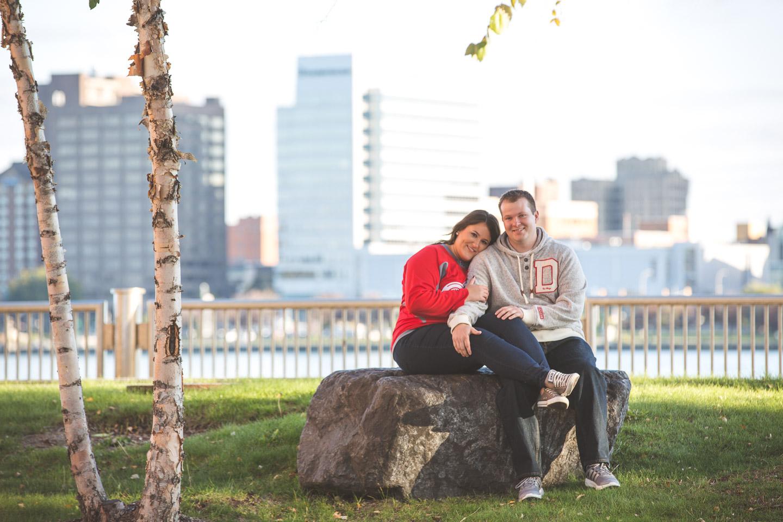 Engagement-Detroit-River-Walk-Couple-Sitting-Park