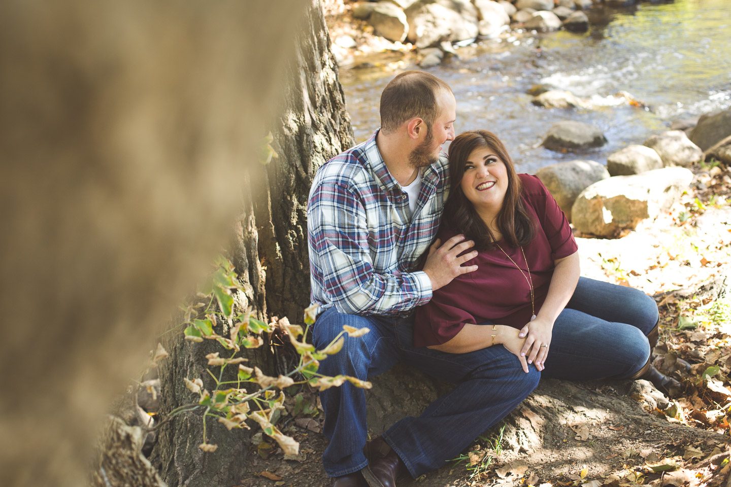 Engagement-Northville-Mill-Race-Village-David-Danielle-Sitting-Near-Creek-River-Tree