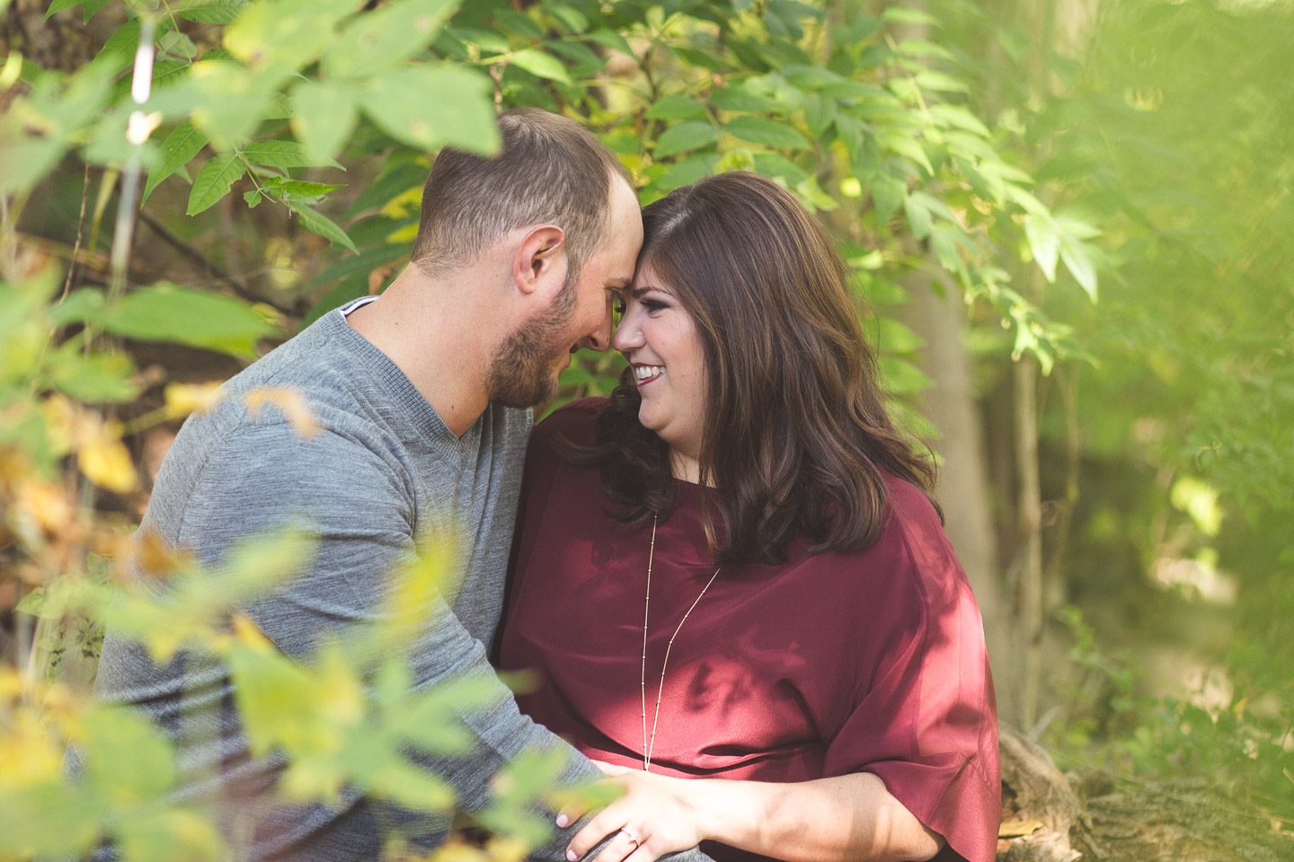 Engagement-Northville-Mill-Race-Village-David-Danielle-Sitting-Shoot-Through-Leaves