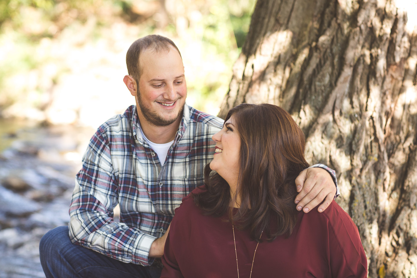 Engagement-Northville-Mill-Race-Village-David-Danielle-Sitting-At-Creek-River