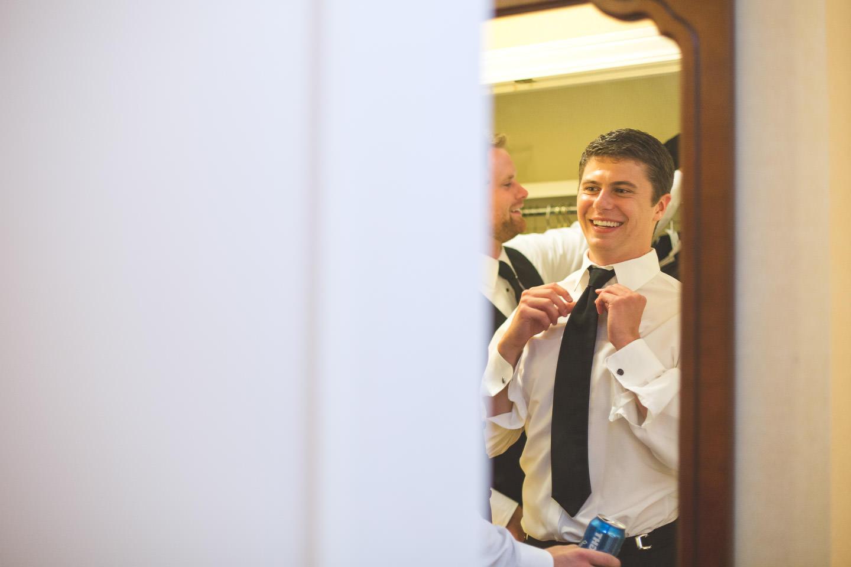 Dearborn-Wedding-The-Dearborn-Inn-Groom-Fixing-Tie